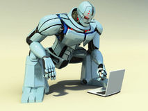 Robot With A Computer Stock Images