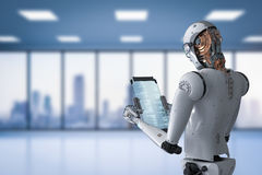 Robot working with digital tablet Royalty Free Stock Photo