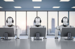 Robot working with headset and monitor Stock Images