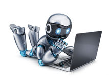 Robot working on laptop Royalty Free Stock Photography