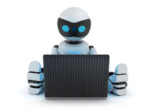 Robot working on laptop Stock Photo