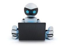 Robot working on laptop Stock Photo