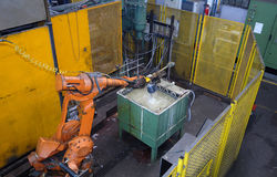A robot working at a metal foundry royalty free stock images