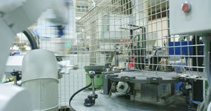 Robot working in a production line. Of parts for the automotive industry