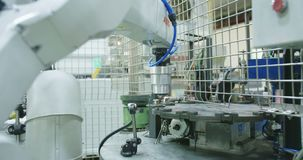 Robot working in a production line. Of parts for the automotive industry stock video footage