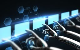 Robot wręcza wzruszających wirtualnych ekrany nad czernią Obraz Royalty Free