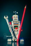 Robot with wrench and red pencil Stock Images