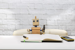 Robot writes in diary pen of black color, the robot works Stock Photo