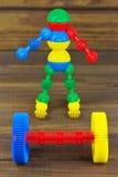 Robota barbell i sportowiec Fotografia Royalty Free
