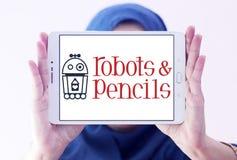 Robotar och blyertspennor fäster logo Arkivbilder