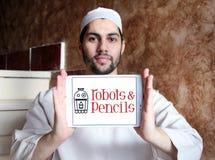 Robotar och blyertspennor fäster logo Arkivbild