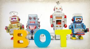 Robotar och ordet BOT Fotografering för Bildbyråer