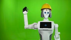 Roboter im Sturzhelm eines Erbauers winkt zum Abschied und spricht Grüner Bildschirm stock video footage