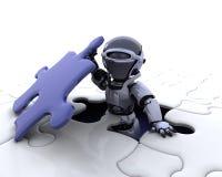Roboter mit dem abschließenden Stück des Puzzlespiels Stockfoto
