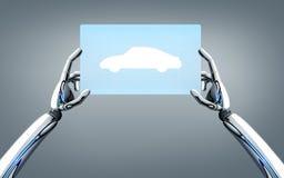 Roboterhände mit Konzeptauto auf Tabletten-PC-Schirm Lizenzfreies Stockbild