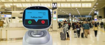 Robotic advisor technology concept,airport use robotic advisor for help passenger and give information about the flight ,boarding. Pass, time and direction to stock photos
