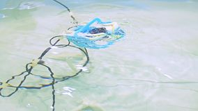 Robotic Aqua Bot Rover Swimming Pool. Slow motion. Close up stock video footage