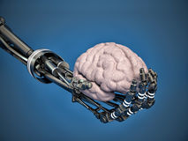 Robotic arm holding a human brain Stock Photos