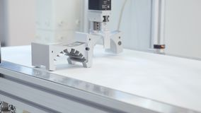 Robotic arm lifts detail. Media. The robotic arm use in detail parts production line. The hi-technology mechanical parts stock footage