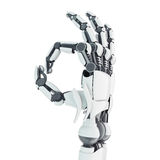 Robotic arm showing Ok. Isolated robotic arm showing Ok on white background Stock Images