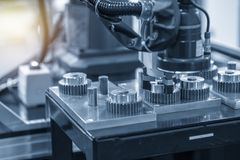 The robotic arm use in gear parts production line. stock photo
