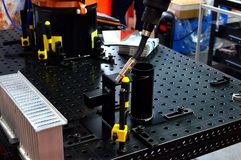 Robotic arm for welding in industrial plant stock photography
