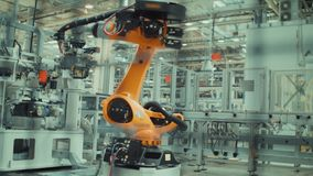 Robotic Arm is Working. Robotic Arm Assembles Parts for a Car stock video