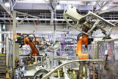 Robotic arms in a car factory Stock Images