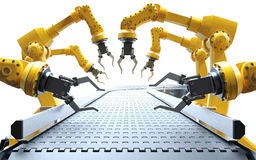 Robotic arms with conveyor belt Royalty Free Stock Image
