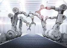Robotic arms with empty conveyor belt Royalty Free Stock Photo