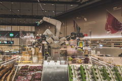 Robotic arms at Expo 2015 in Milan, Italy. MILAN, ITALY - MAY 4: Robotic arms inside a futuristic supermarket at Expo, universal exposition on the theme of food Royalty Free Stock Photos
