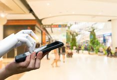 Robotic artificial intelligence transition human hand to robot hand press the smartphone button. Or shopping mall background stock images