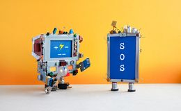 Robotic computer with hand wrench and broken cellular smartphone, message SOS on blue screen. Robotic computer with hand wrench and broken cellular smartphone stock photos
