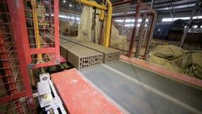 Robotic conveyor cutting and assembling bricks. stock footage