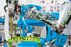 Robotic hand control robot industry in automotive manufacture, Future technology concept royalty free stock image