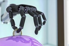 A robotic hand with a euro coin. 3d rendering Royalty Free Stock Image