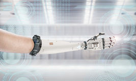 Robotic hand extended from human arm. 3d rendering robotic hand extended from human arm Stock Images
