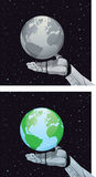 Robot hand holding planet Stock Photo