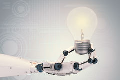 Robotic hand with light bulb. 3d rendering robotic hand with light bulb Royalty Free Stock Photo
