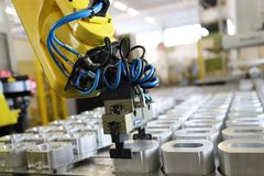 Robotic arm machine tool at industrial manufacture factory. Robotic hand machine working at industrial manifacture stock photos