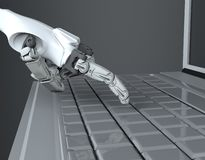 Robotic Hand Pressing Enter Key On Keyboard. 3d rendering. working with computer keyboard royalty free stock image