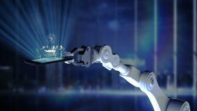 Robotic hand som framlägger den upplysta mobiltelefonen med affärsfolk