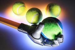 Robotic Hand with Tennis Balls Royalty Free Stock Photos