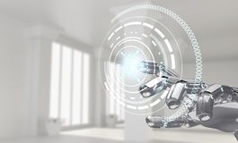 Robotic hand works with icon in virtual reality. 3d rendering. Robotic mechanical hand works with icon in virtual reality. Futuristic design concept. 3d Royalty Free Stock Images