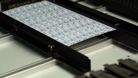 Robotic machine manufactures LED panel, close-up stock video