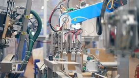Robotic machines create carton boxes on industrial line at a plant. 4K stock video