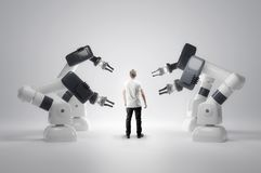 Robotic Machines And Humans. A man standing next to robotic manufacturing machines. Jobs and future workforce concept. 3D illustration stock images