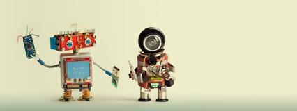 Robotic maintenance repair fix concept. Handyman robots, smiley red head, chip usb flash stick. Mechanic cyborg toy with. Black helmet, electronic accessories Royalty Free Stock Photos