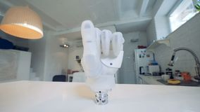 Robotic prosthesis on a table, close up. Prosthetic hand on a table in a room