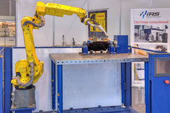 Robotic system for welding and spraying Stock Images